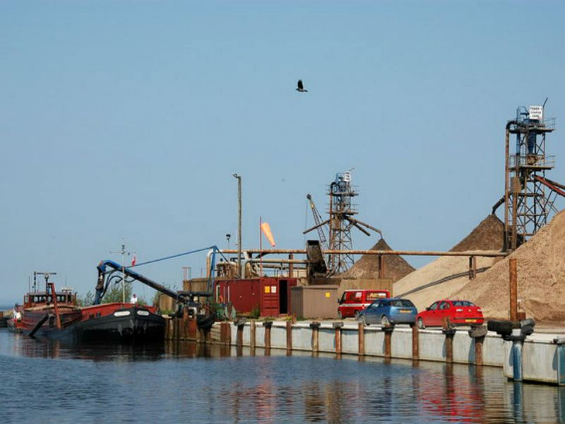 "The sand suction barge ""Bayshore"" discharging her cargo at Emerson's Quay, Lough Neagh"
