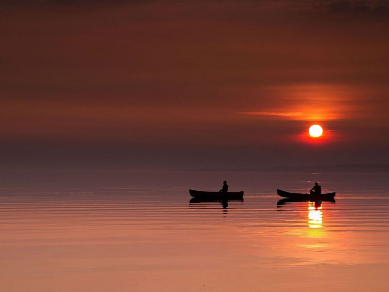 Two canoes on Lough Neagh at sunset