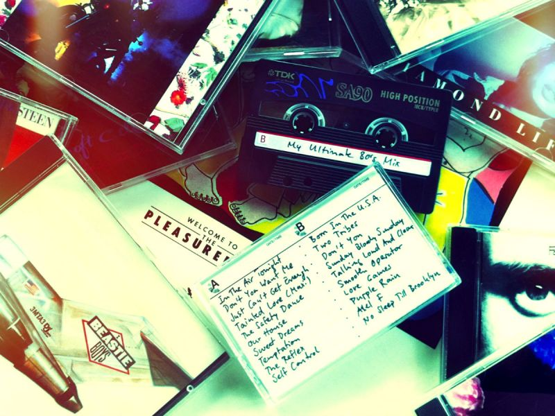 A mixtape on top of scattered CDs