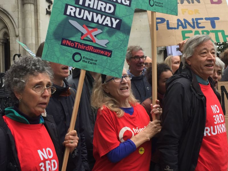 Close-up of Friends of the Earth supporters outside the High Court campaigning against a third Heathrow runway.