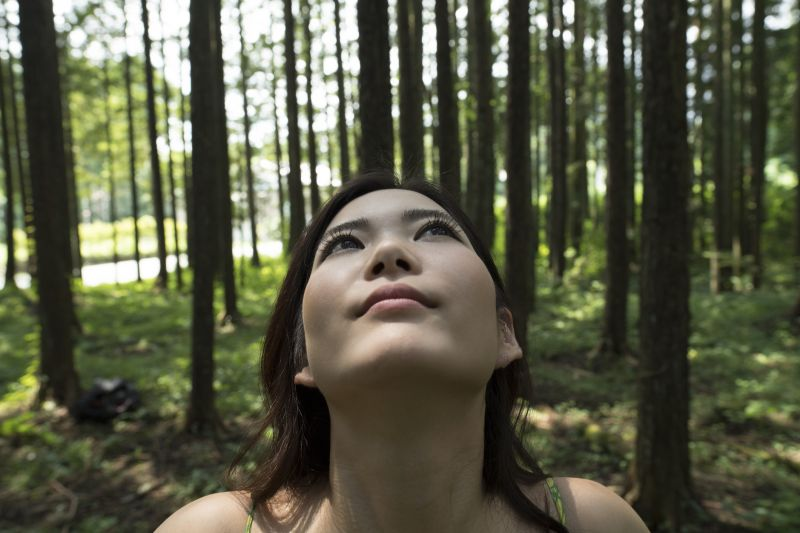 Tree facts: a woman breathing in the fresh air of the forest