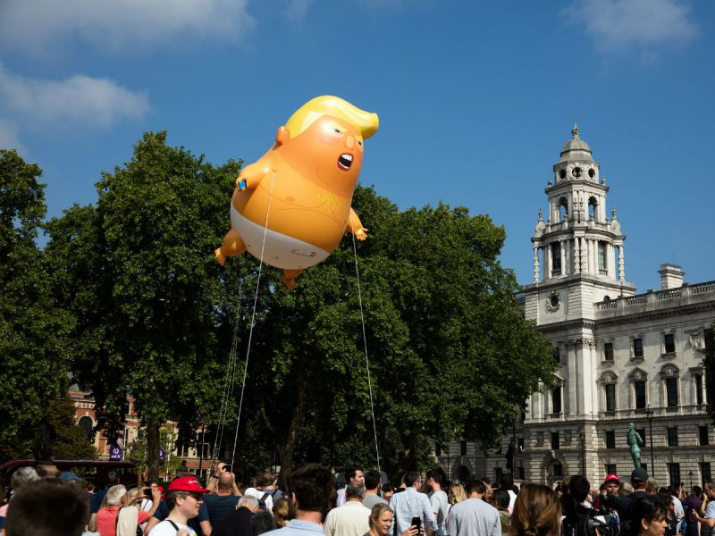 Trump baby blimp flying at the Trump protest in London, July 2018