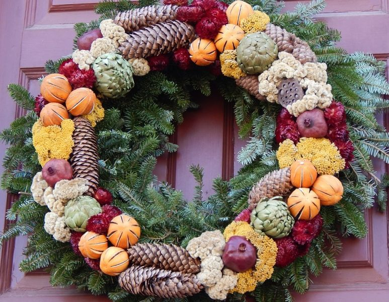 Christmas wreath with dried flowers, fruits etc on door