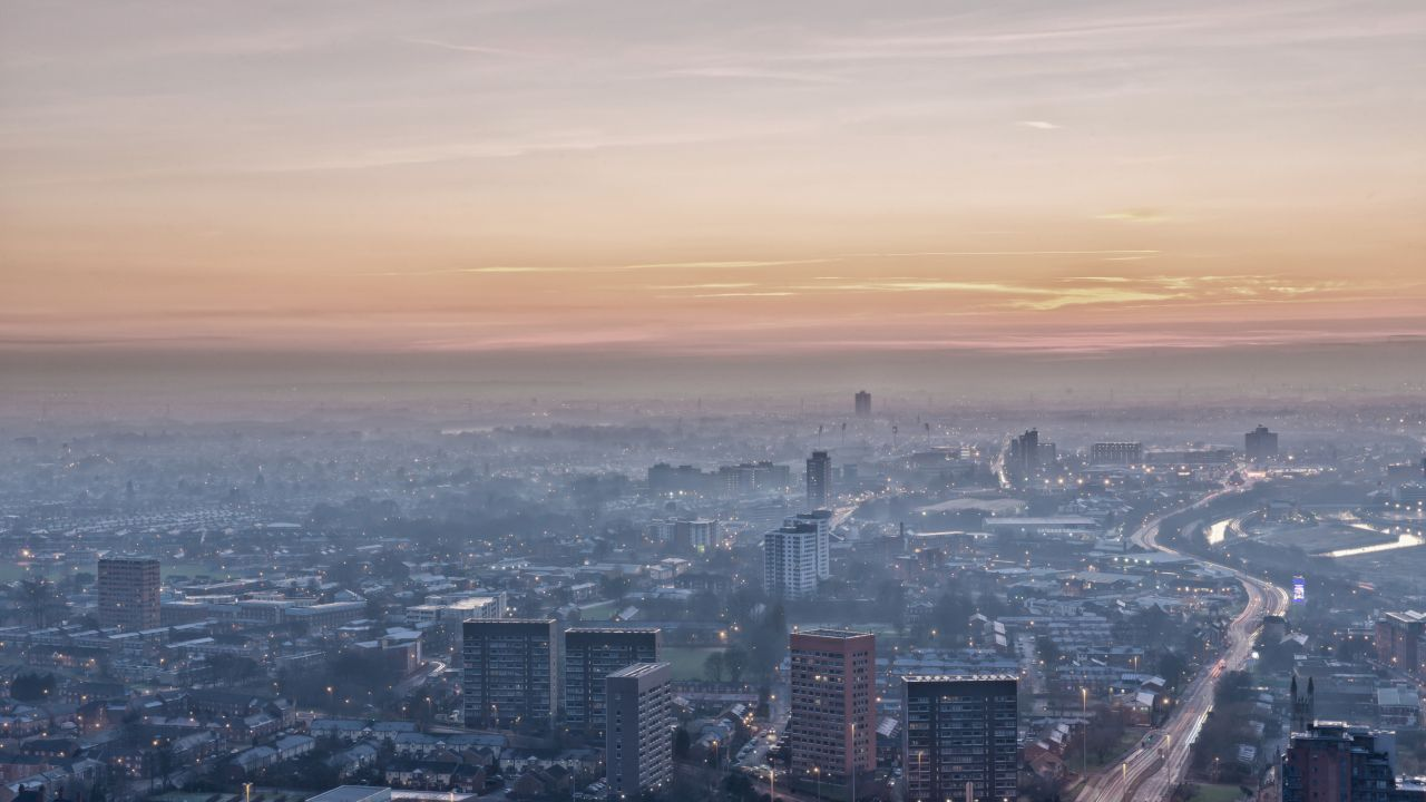 photo of Manchester from the air with haze over the city
