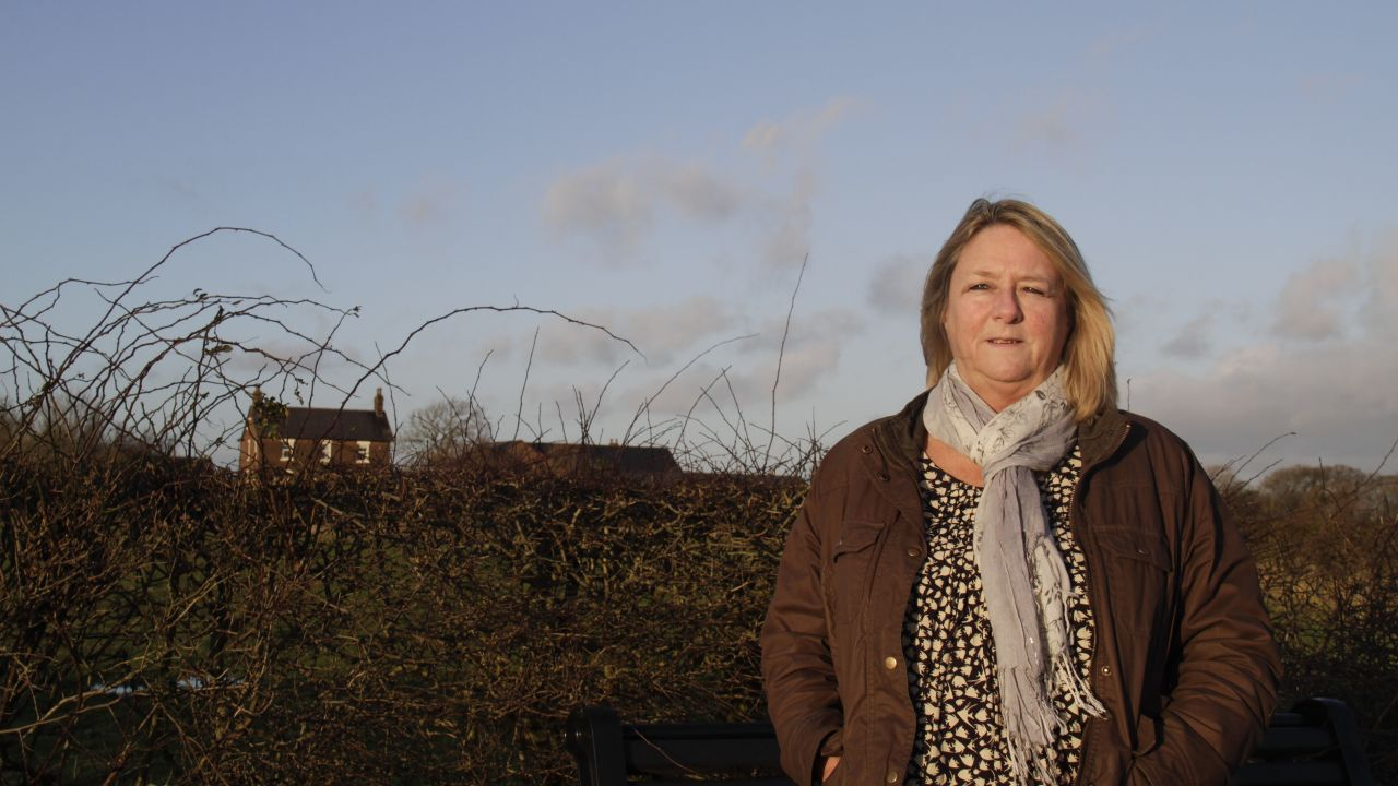 Barbara Richardson standing at the end of her driveway, which is the proposed Roseacre fracking site
