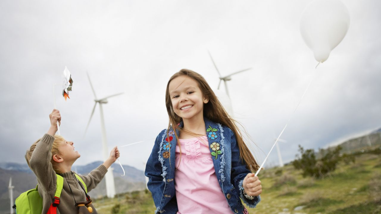Children in front of wind turbines