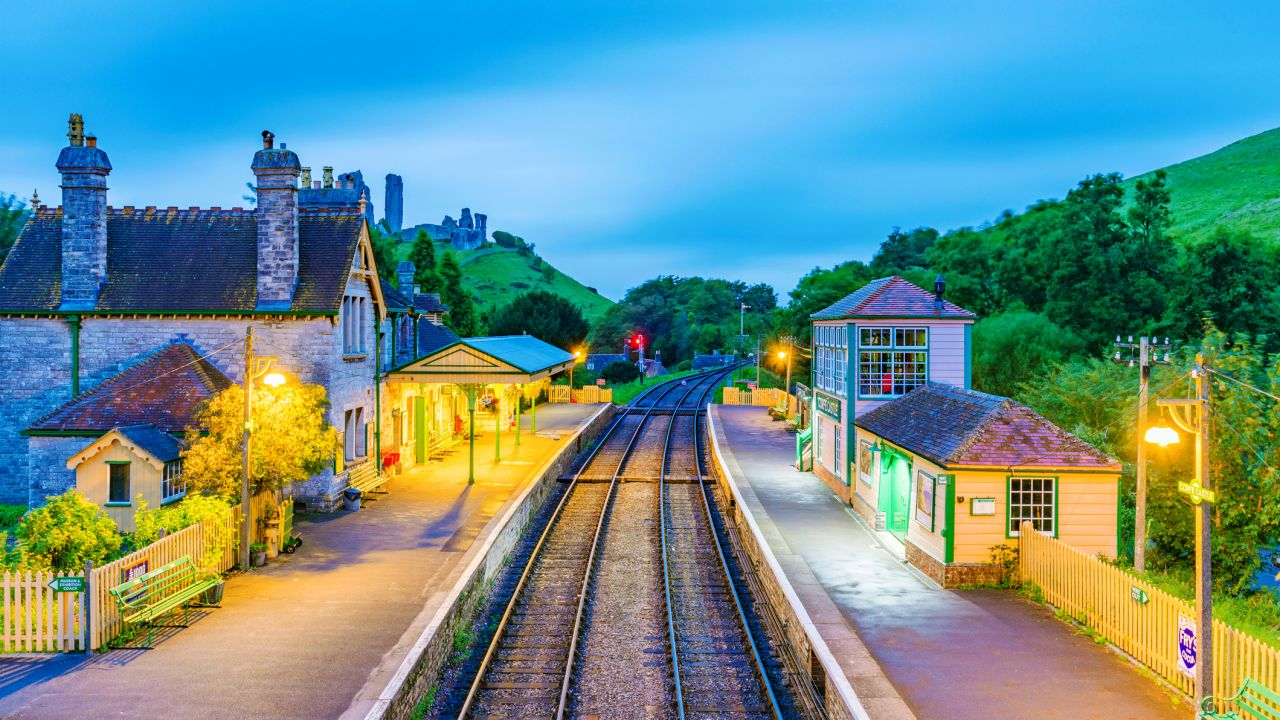 An evening view of Corfe Castle railway station with no one in sight