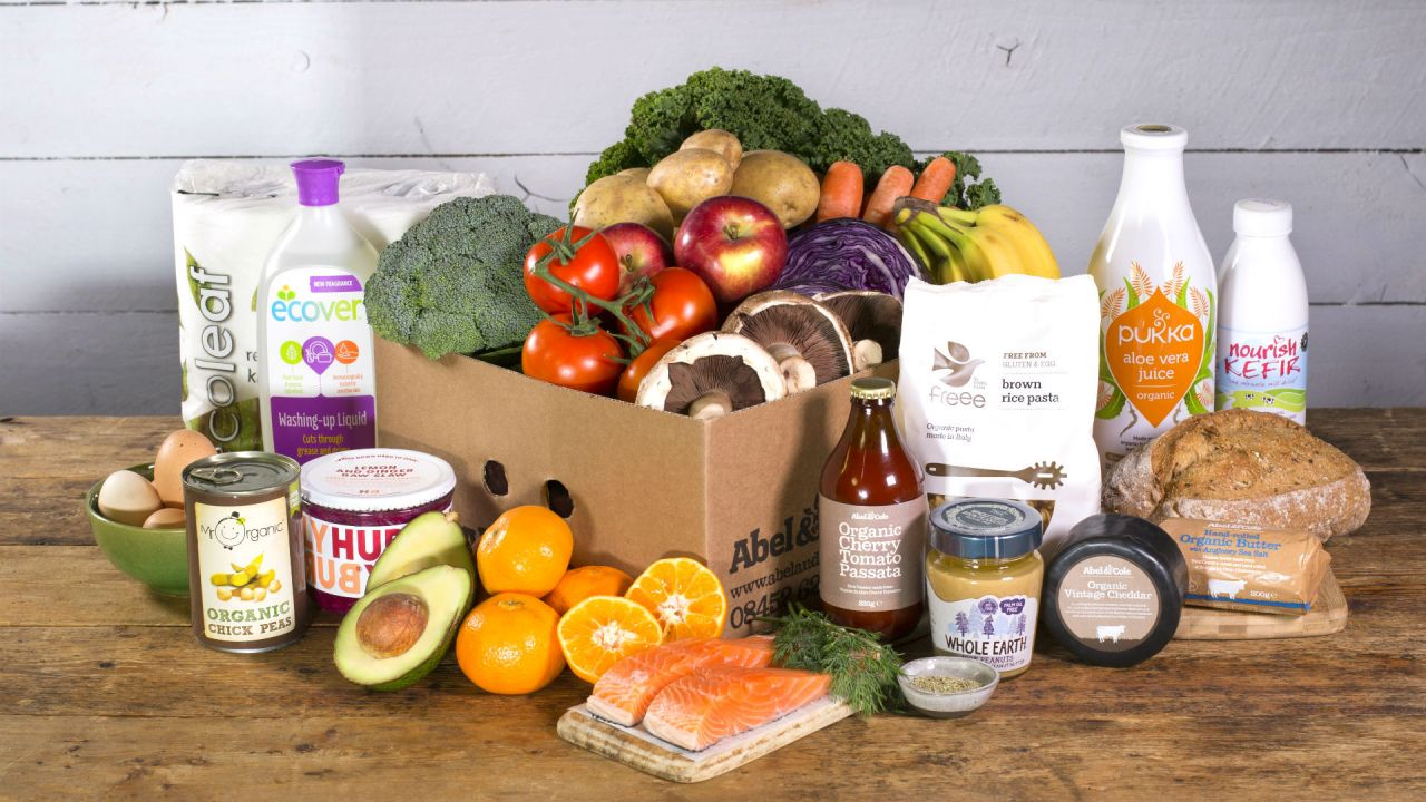 Abel & Cole organic food box with fruit, vegetables, bread, drinks, salmon, eggs and cleaning materials.