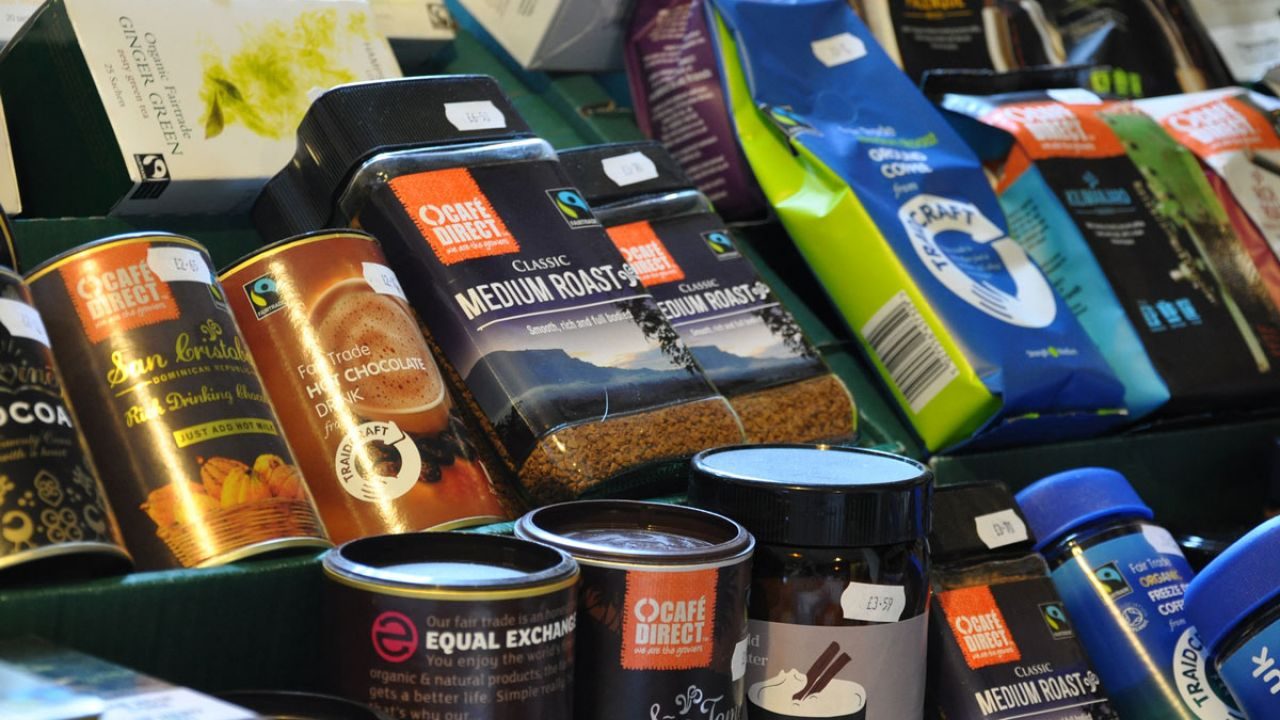 Packs of coffee, tea and cocoa with Fairtrade logo