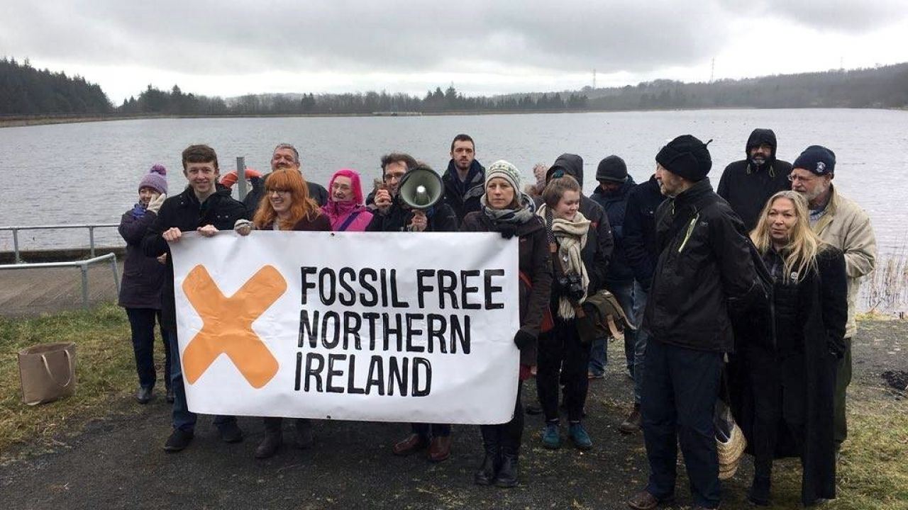 Campaigners holding a 'Fossil Free Northern Ireland' banner