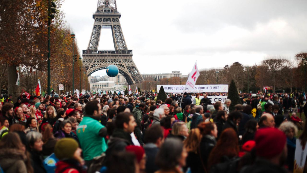 Lots of people join a rally in front of the Eiffel Tower during the Paris Climate Change talks