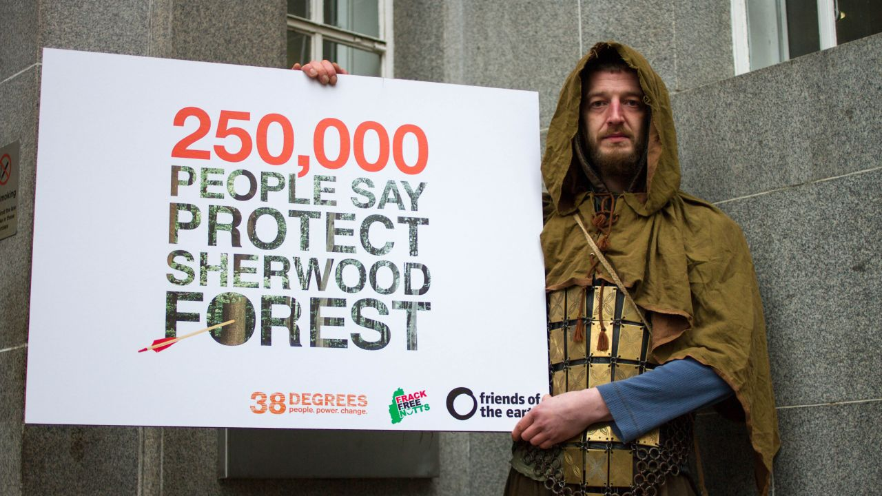 "Actor as Friar Tuck with petition placard saying ""250,000 PEOPLE SAY PROTECT SHERWOOD FOREST"""
