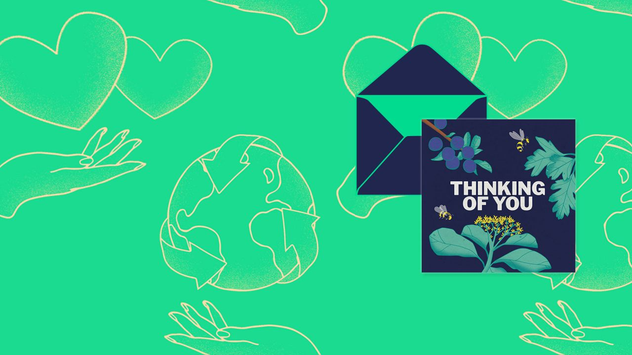 "An e-card that says ""Thinking of you"" hovers over and open envelope"