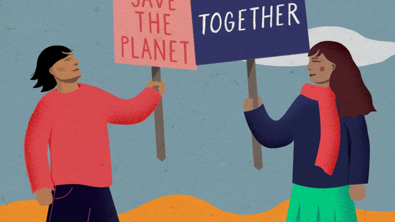 Couple protesting to save the planet together