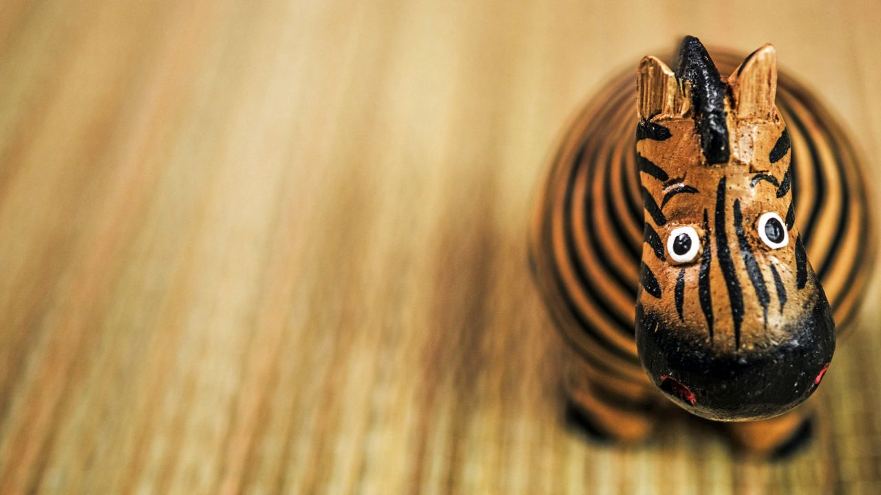 Striped wooden toy zebra