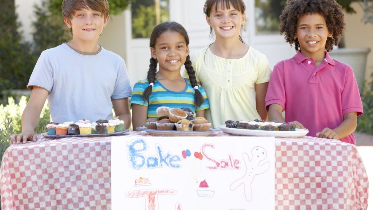 4 children running a cake stall