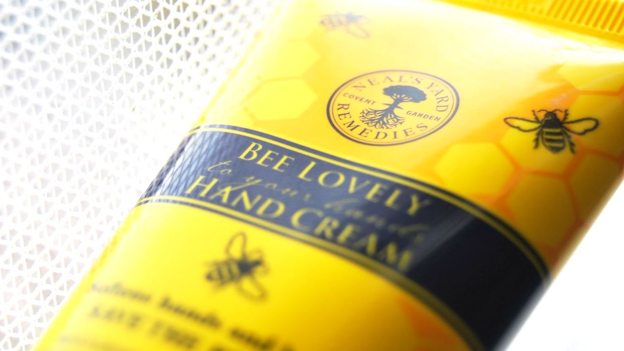 A close-up of a tube of bee lovely hand cream by Neal's Yard Remedies
