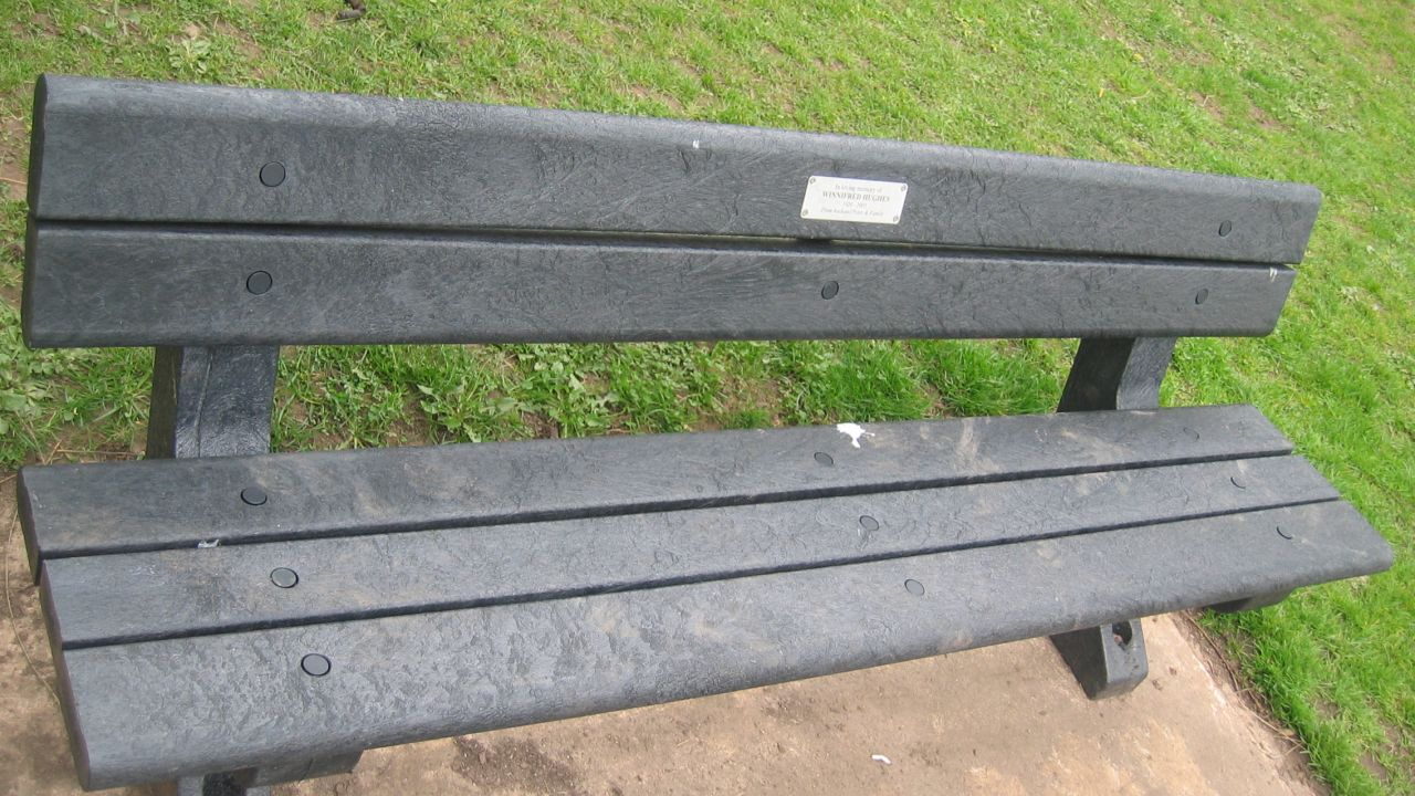 A bench made from old plastic bags in park or similar area