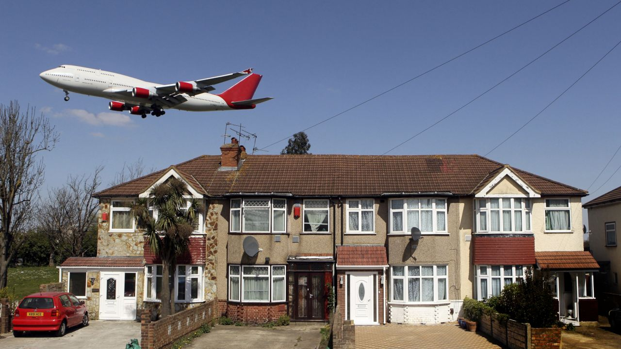 An aeroplane coming into land at Heathrow airport, London, UK