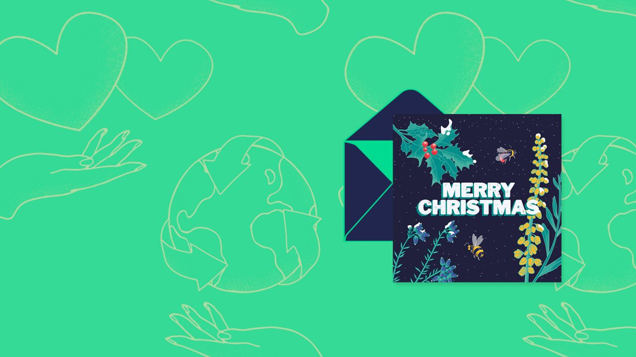 Merry Christmas card hovering above an open envelope