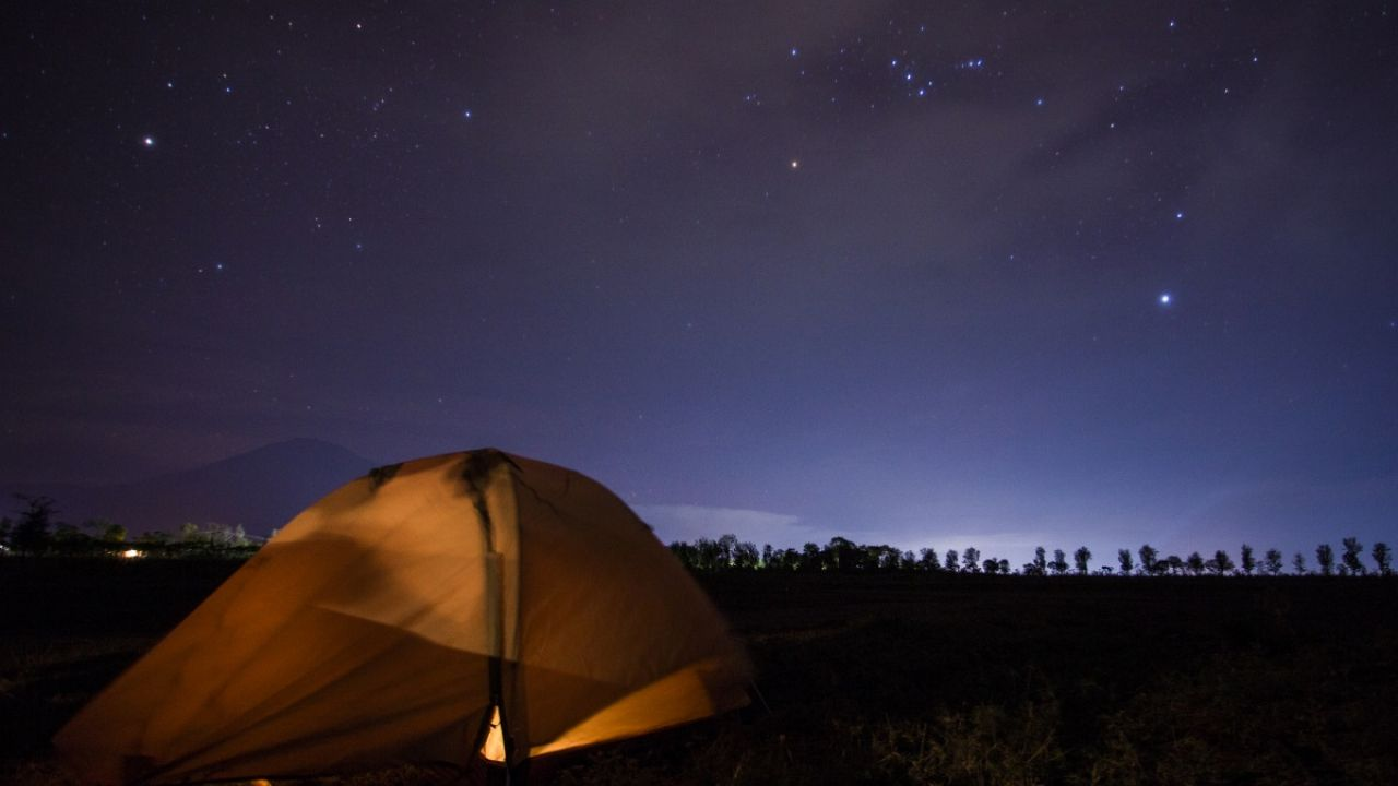 Tent in the countryside at night