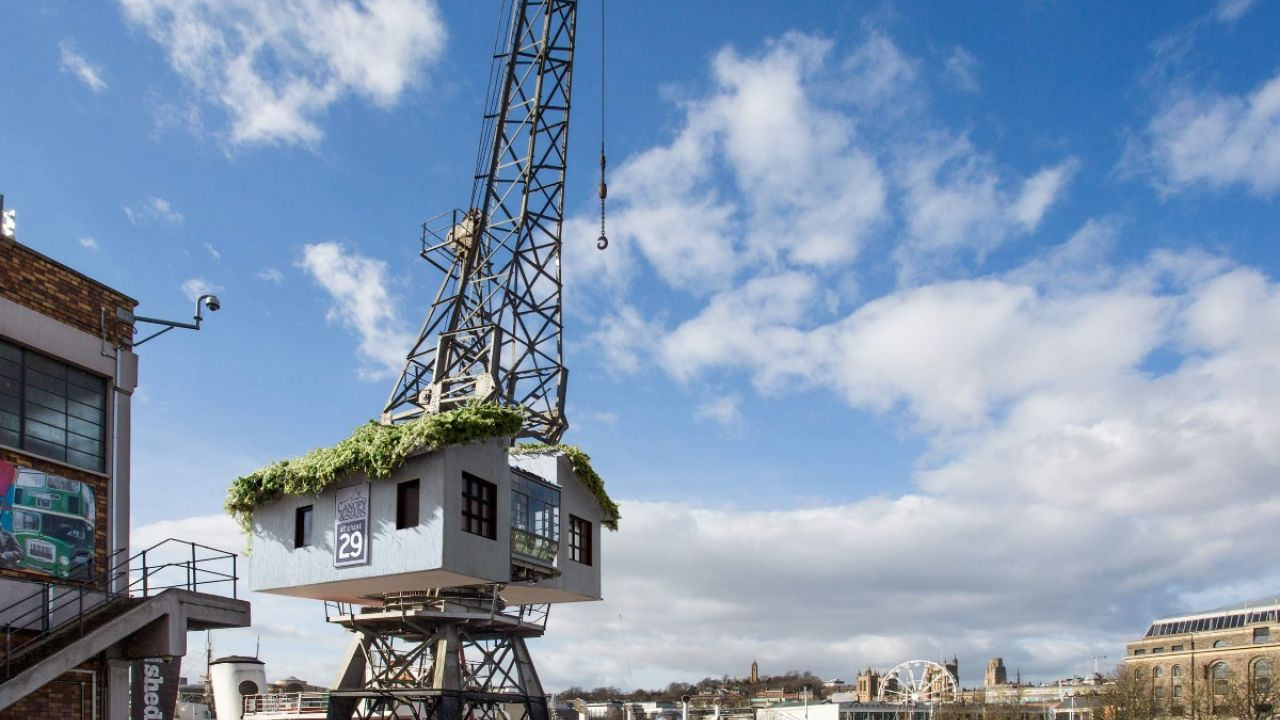 A treehouse in a crane over the docks in Bristol