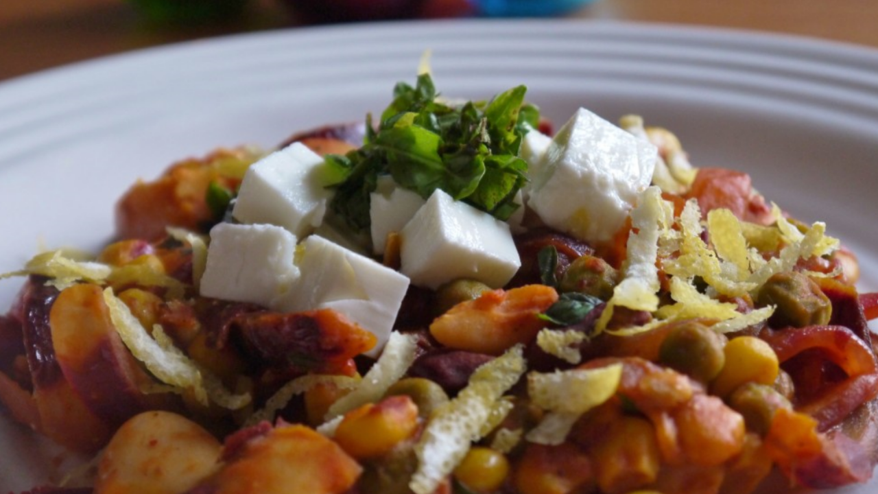Harissa, kidney bean and chickpea one pot dinner with feta and fresh herbs