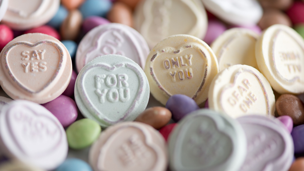 Close up image of love hearts and other romantic sweets