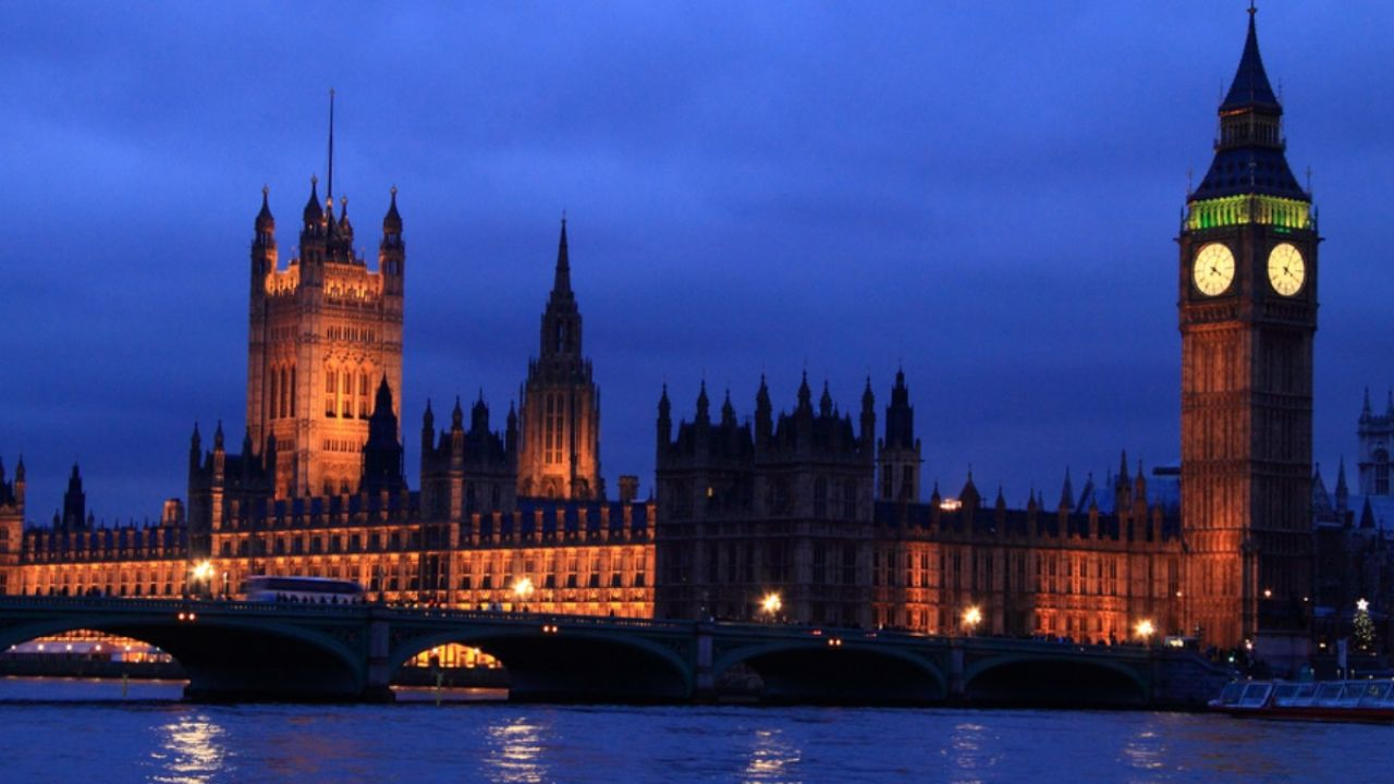 UK parliament at night, over the river Thames