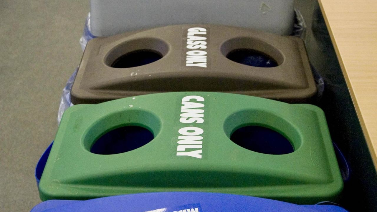 Recycling bins in a line in an office