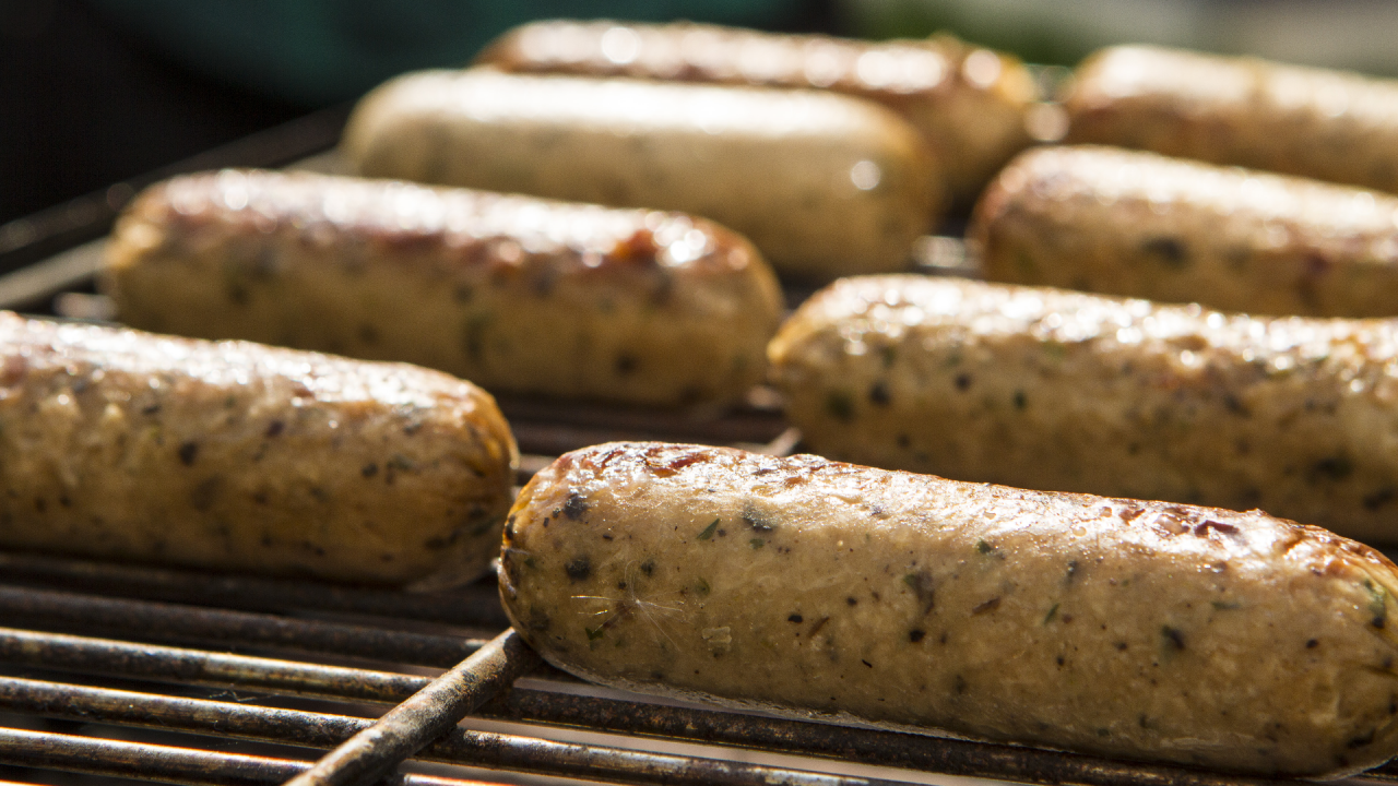 Meat-free sausages on a barbecue grill