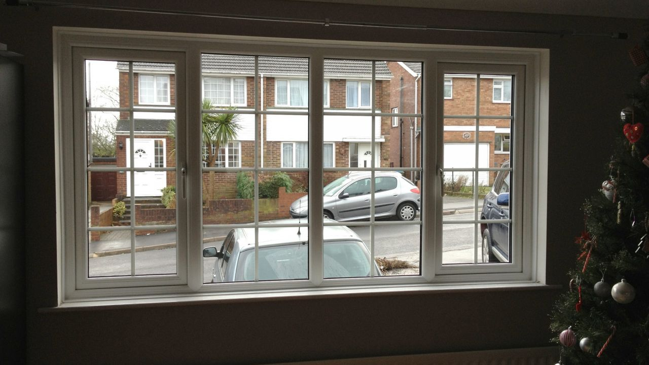 Double-glazed windows looking out from a property on to a residential street
