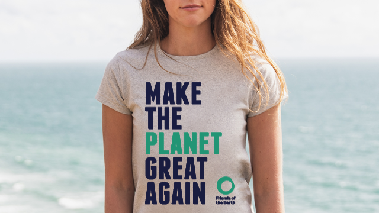 female model wearing Make the Planet Great Again tshirt