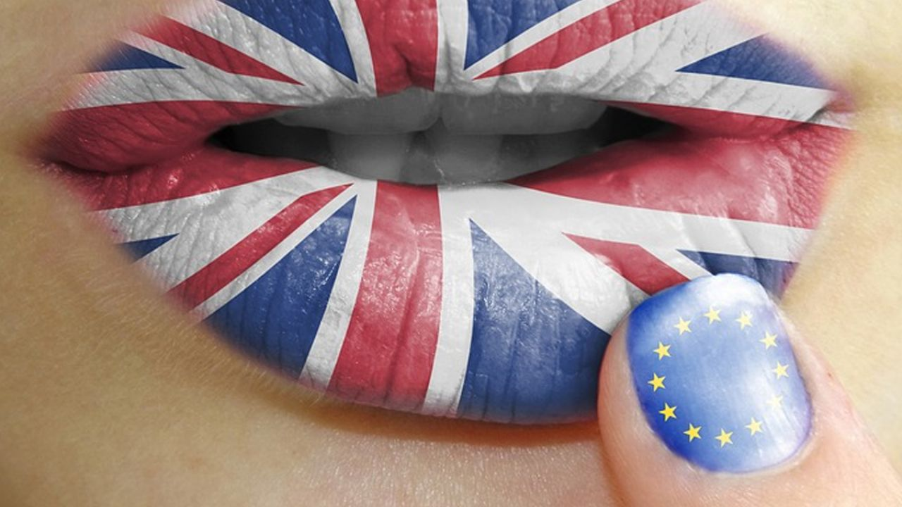 Union Jack lips and an EU flag finger representing Britain leaving the European Union