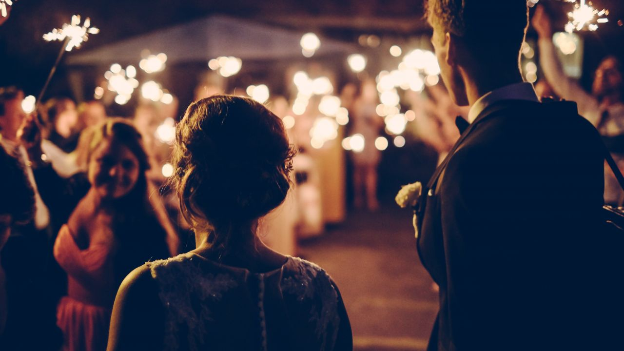 Night time garden party with sparklers. Cocktail party or wedding