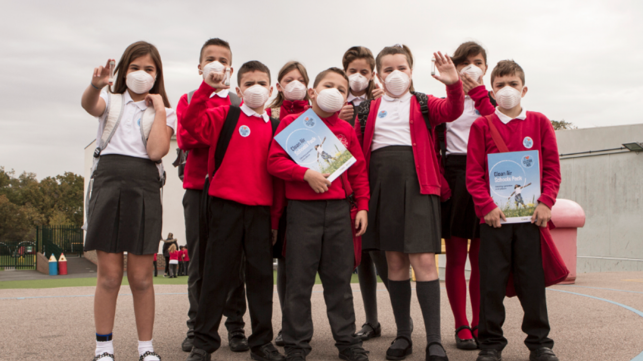 School kids with Clean Air school packs and air monitoring tubes