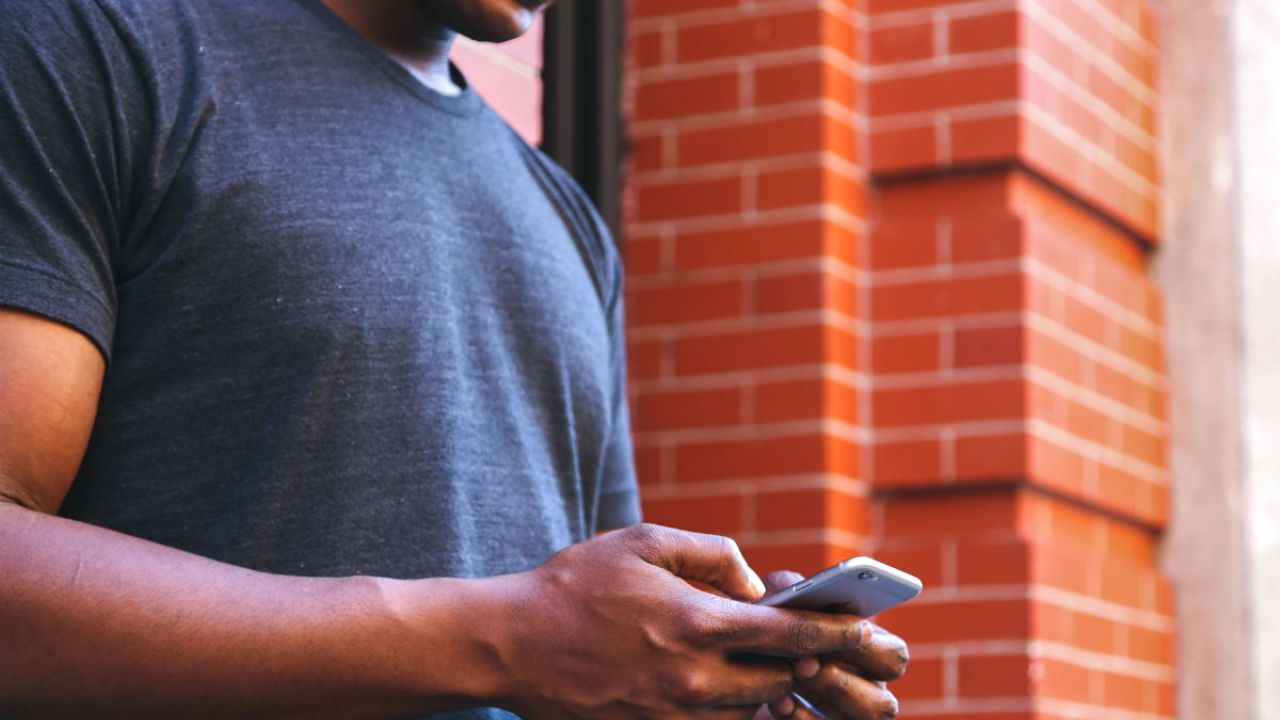 A man texting on his phone