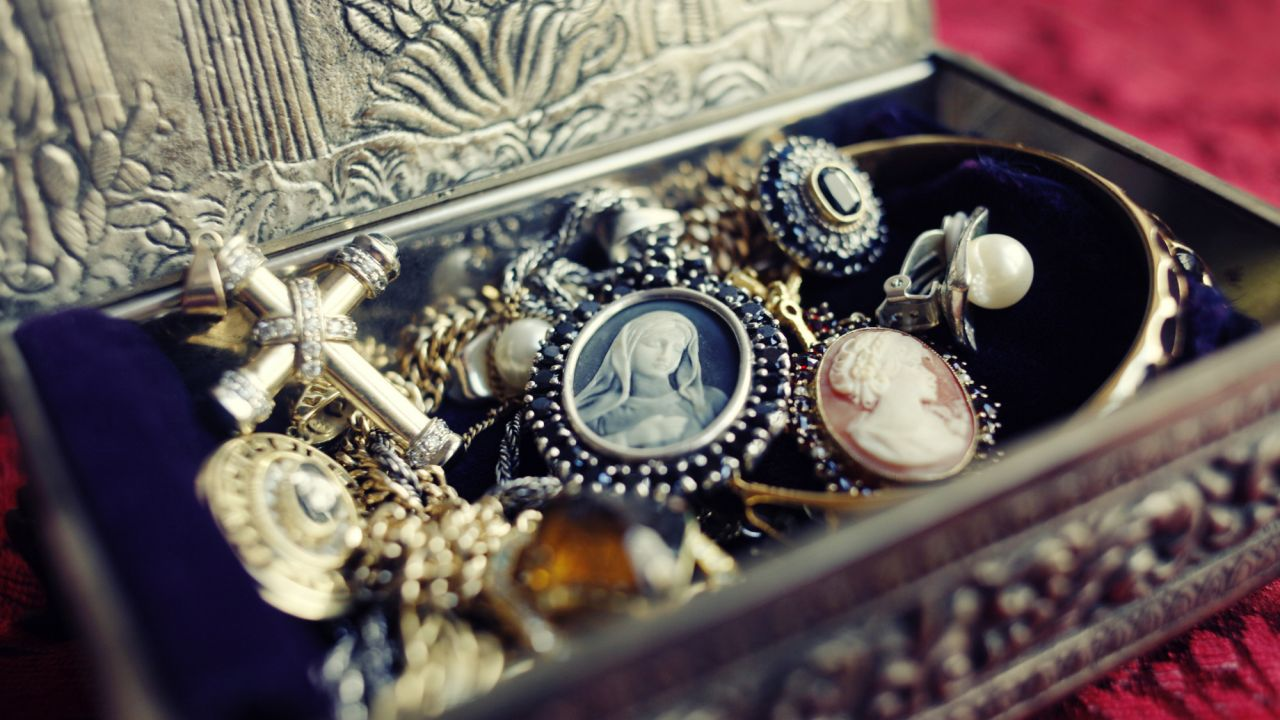 Open jewellery box, with bracelets, rings, and pendants