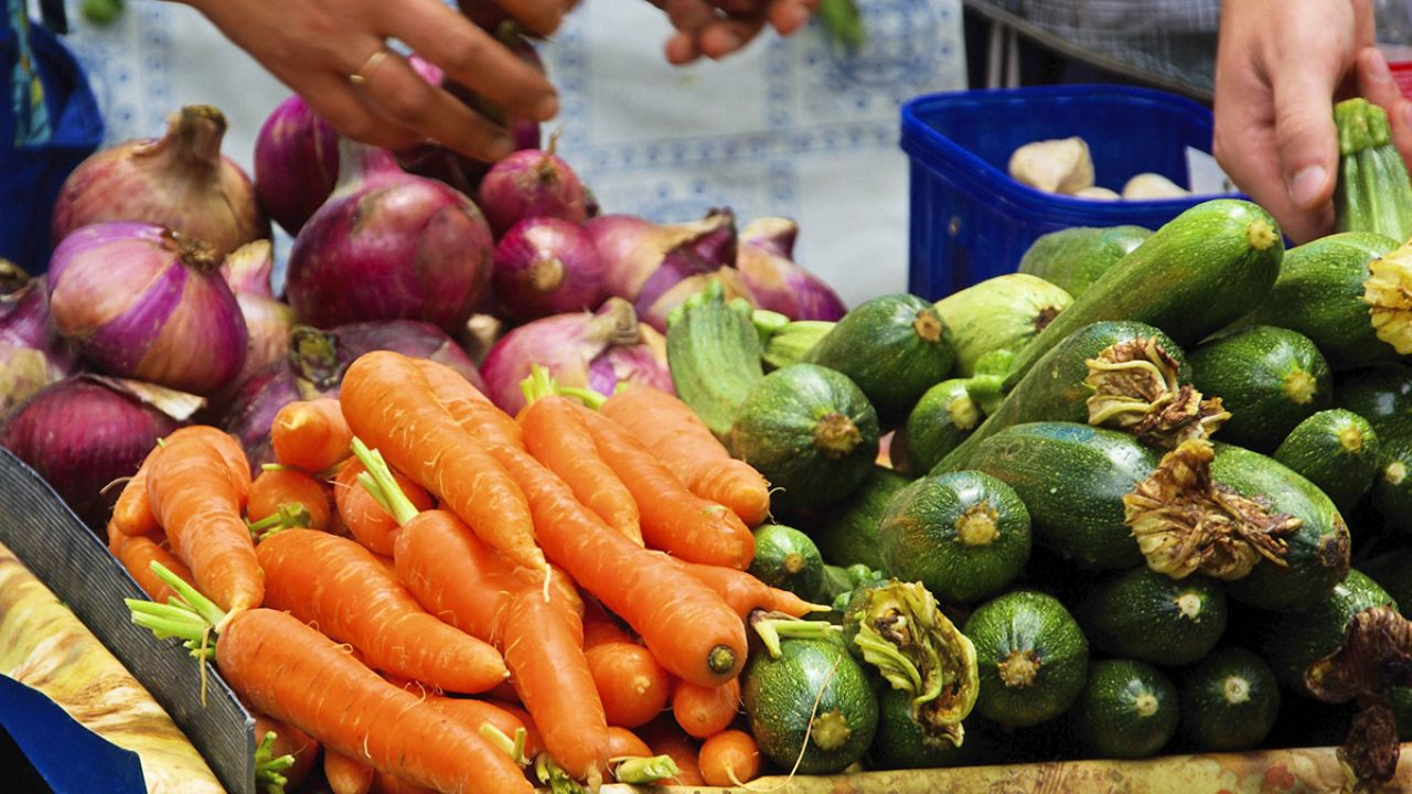 Carrots and courgettes in a fruit and vegetable market