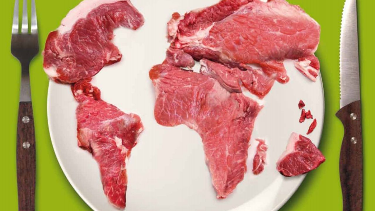 Front cover of the Meat Atlas, showing a globe created from meat on a plate, alongside a knife and fork