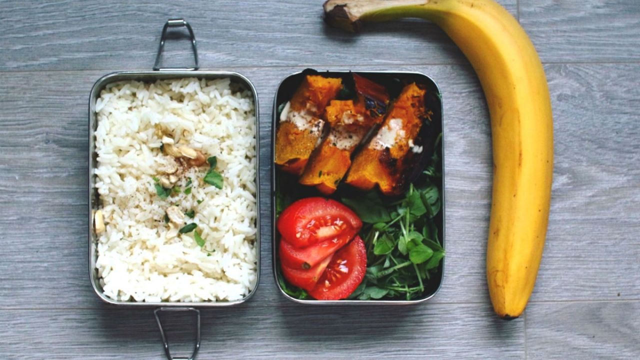 photo of metal lunch box with rice, veg and banana