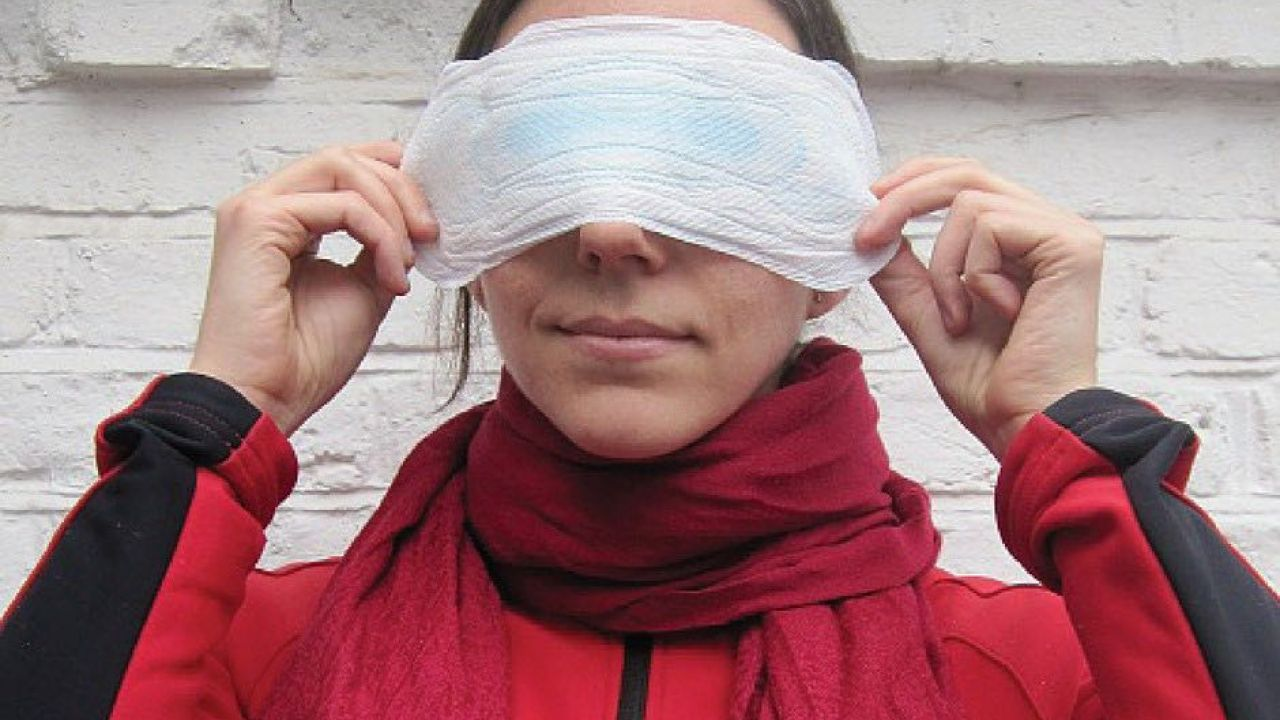 photo of woman holding sanitary pad