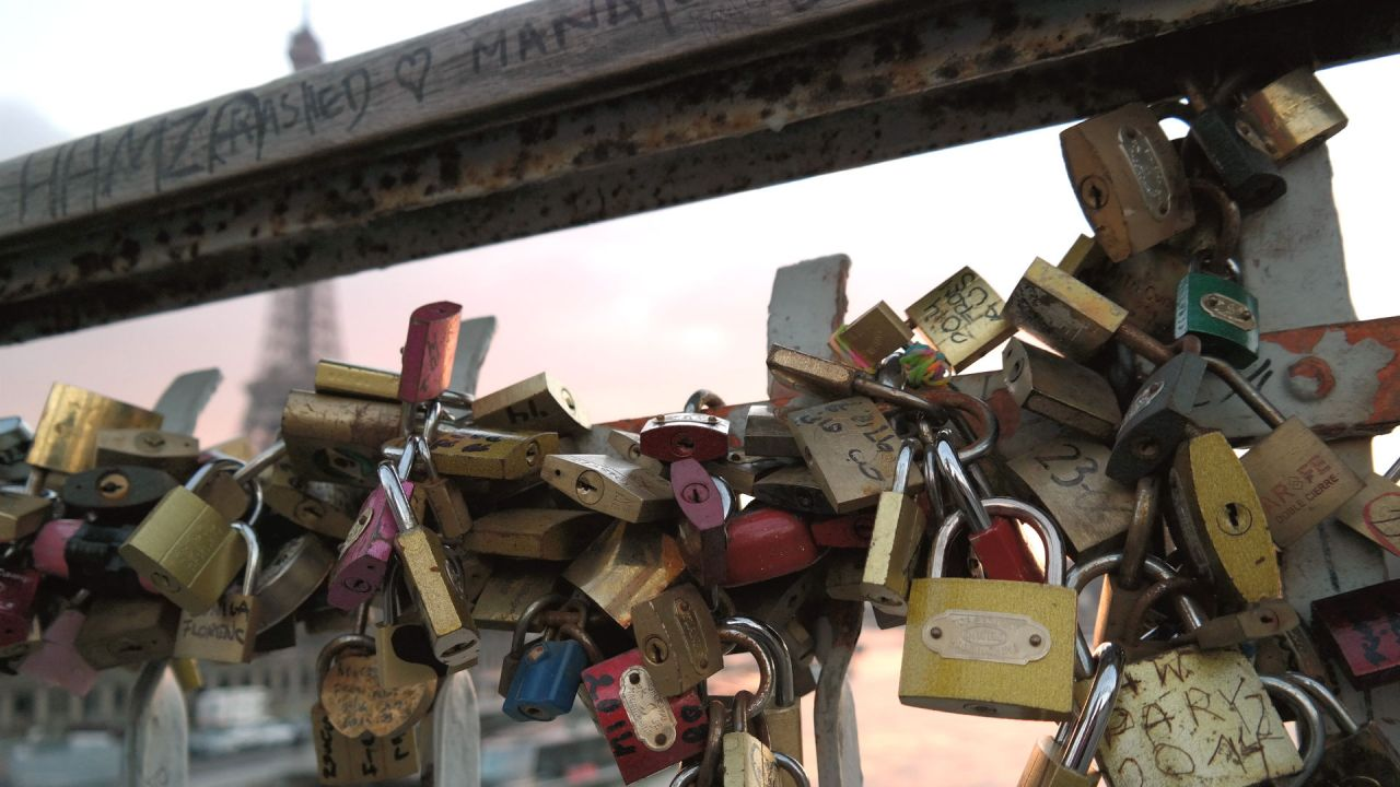 Padlocks symbolically fastened to one of the French capital's main bridges by loved-up couples