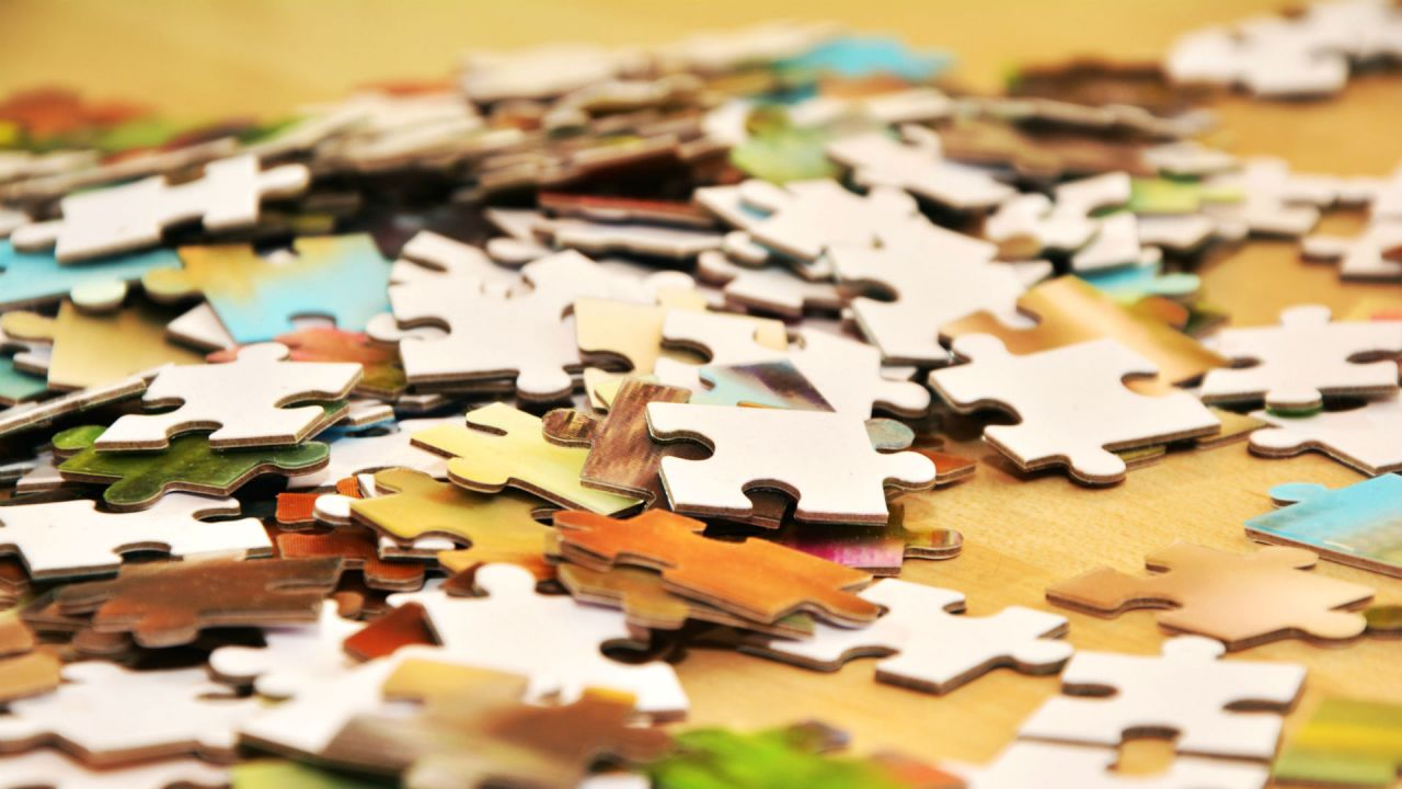 A jigsaw puzzle in pieces