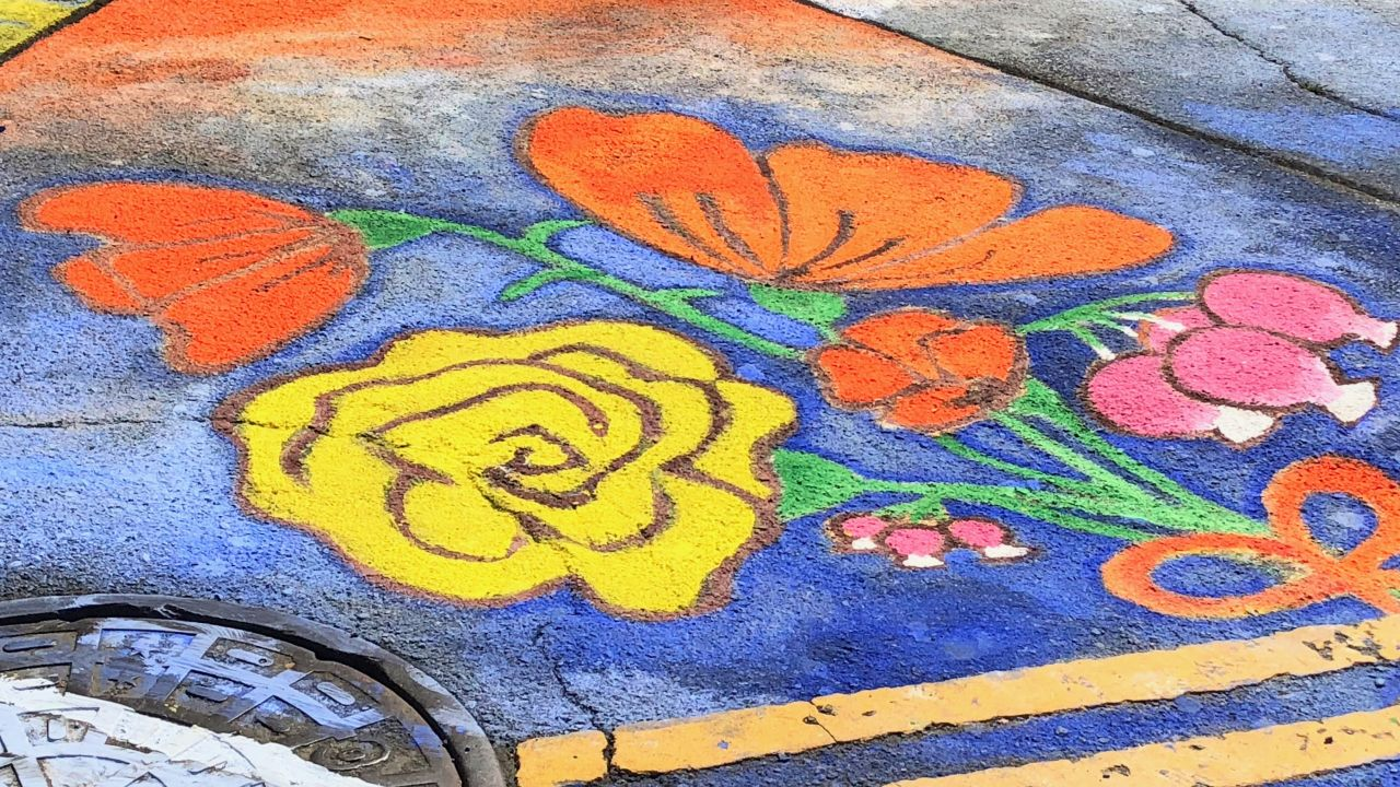 A painting of flowers sprayed on to the road from Climate Action March on Sep. 8, 2018, San Francisco