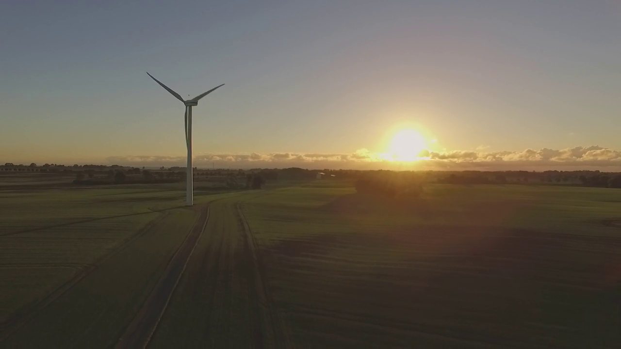 Wind turbine at sunset