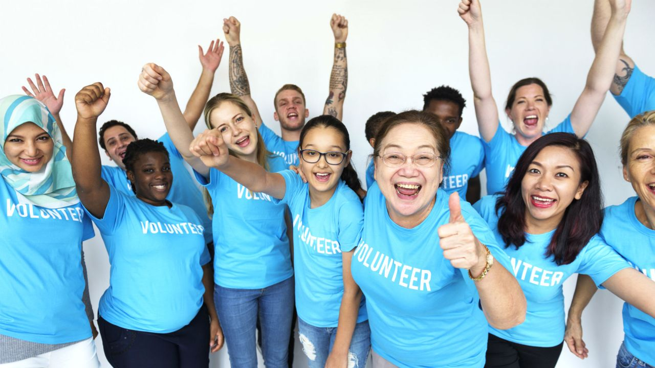 Volunteers wearing matching blue t-shirts