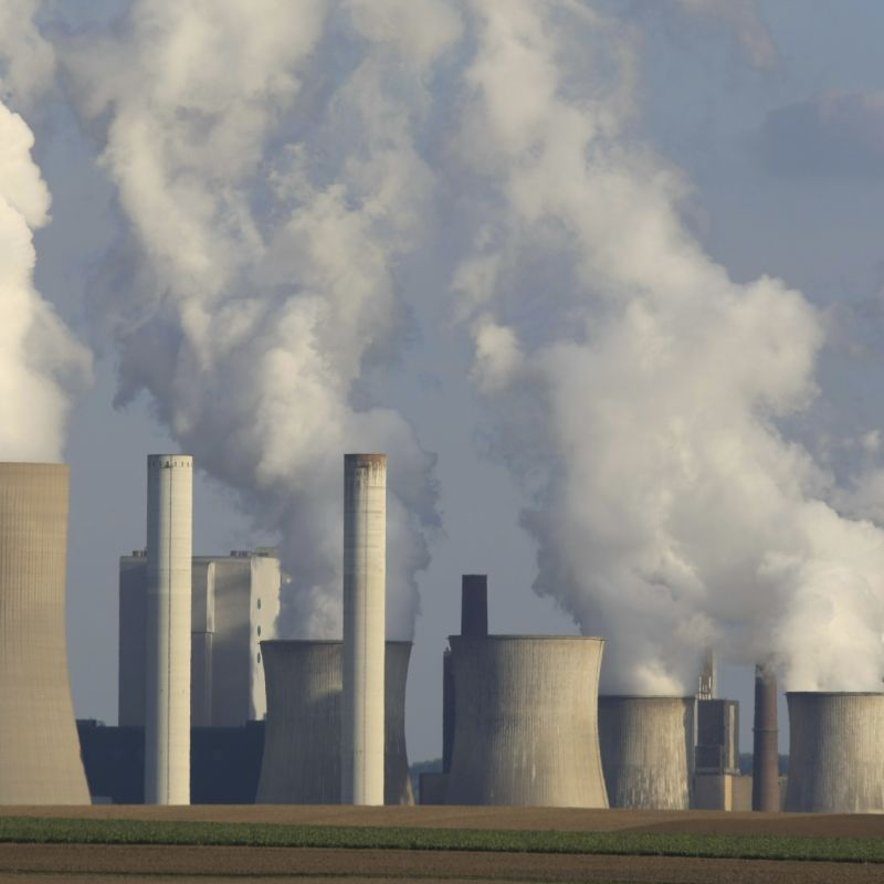 Cooling towers in action at a coal-fired power station
