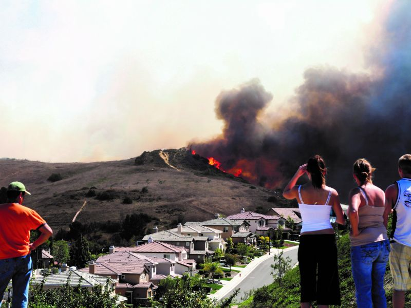 Residents overlooking a wildfire near their homes