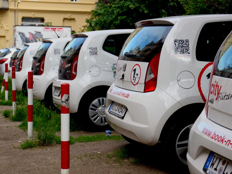 A line of white cars belonging to the City Flitzer car sharing scheme